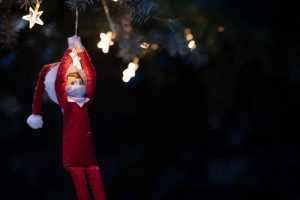 Christmas toy hangs on a glowing garland