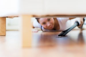 spring cleaning under furniture